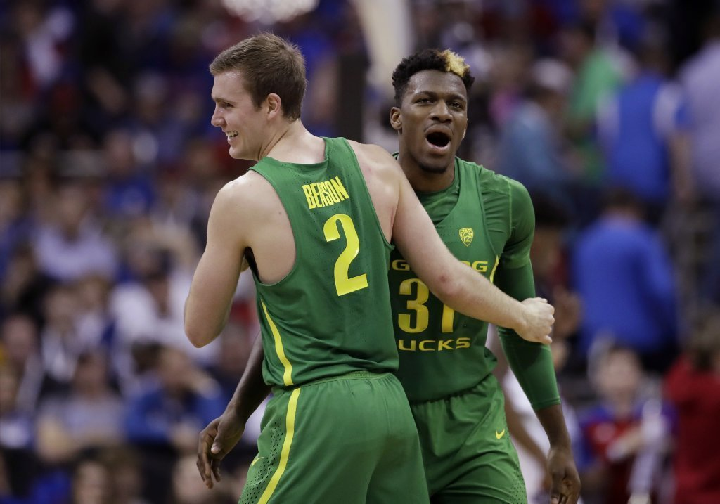 Oregon'a Casey Benson and Dylan Ennis celebrate at the end of the first half an Elite Eight game on the NCAA tournament on March 25. (Charlie Riedel / Associated Press)