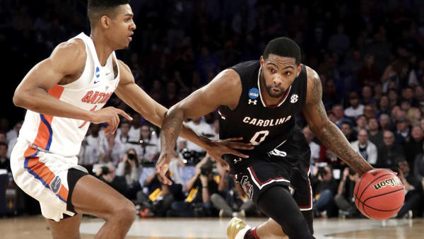 South Carolina guard Sindarius Thornwell (0), who finished with 26 points, tries to drive against Florida forward Devin Robinson during the first half Sunday. (Frank Franklin II / Associated Press)