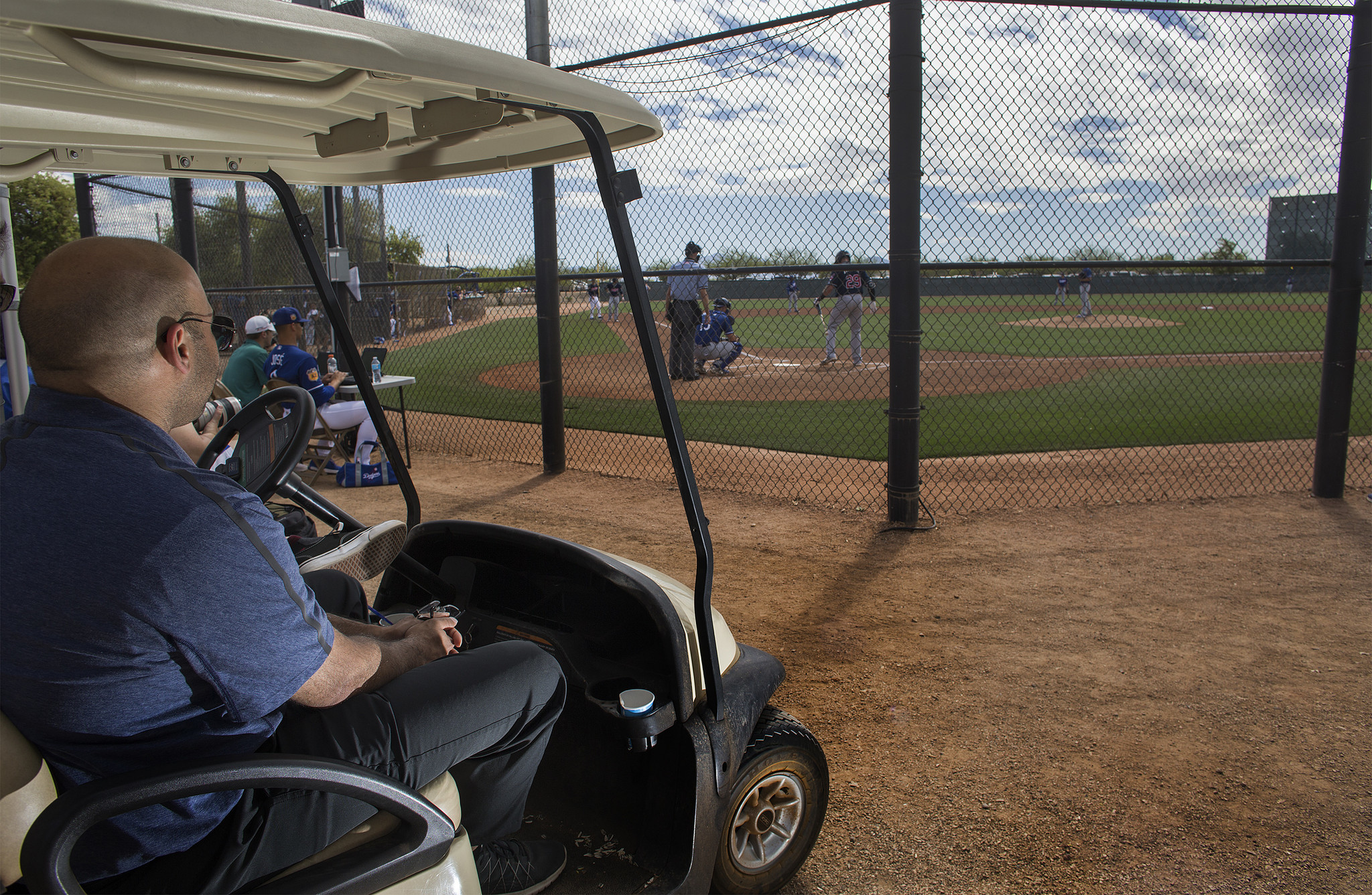 Farhan Zaidi watches a minor league game during spring training at Camelback Ranch. Early in his career with the Oakland Athletics he realized went to numerous minor league and amateur games to develop his eye for baseball talent.