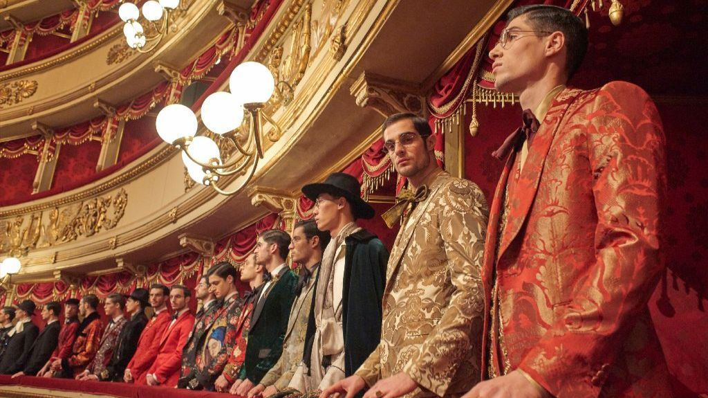 In late January, Italian luxury brand Dolce & Gabbana staged its exclusive Alte Artigianalità in Milan. Here's a look at the models lined up at the men's couture show, Alta Sartoria, along one of the balconies of Teatro alla Scala, which dates back to 1778.