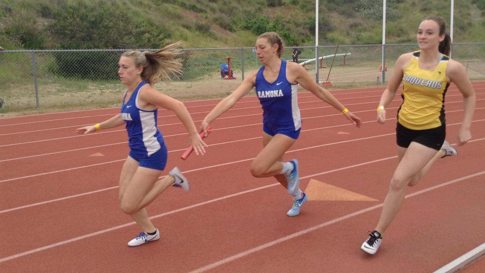 Tuesday Christopher hands the baton to Amber Cogbill en route to their season best 4x100 time of 51.79.
