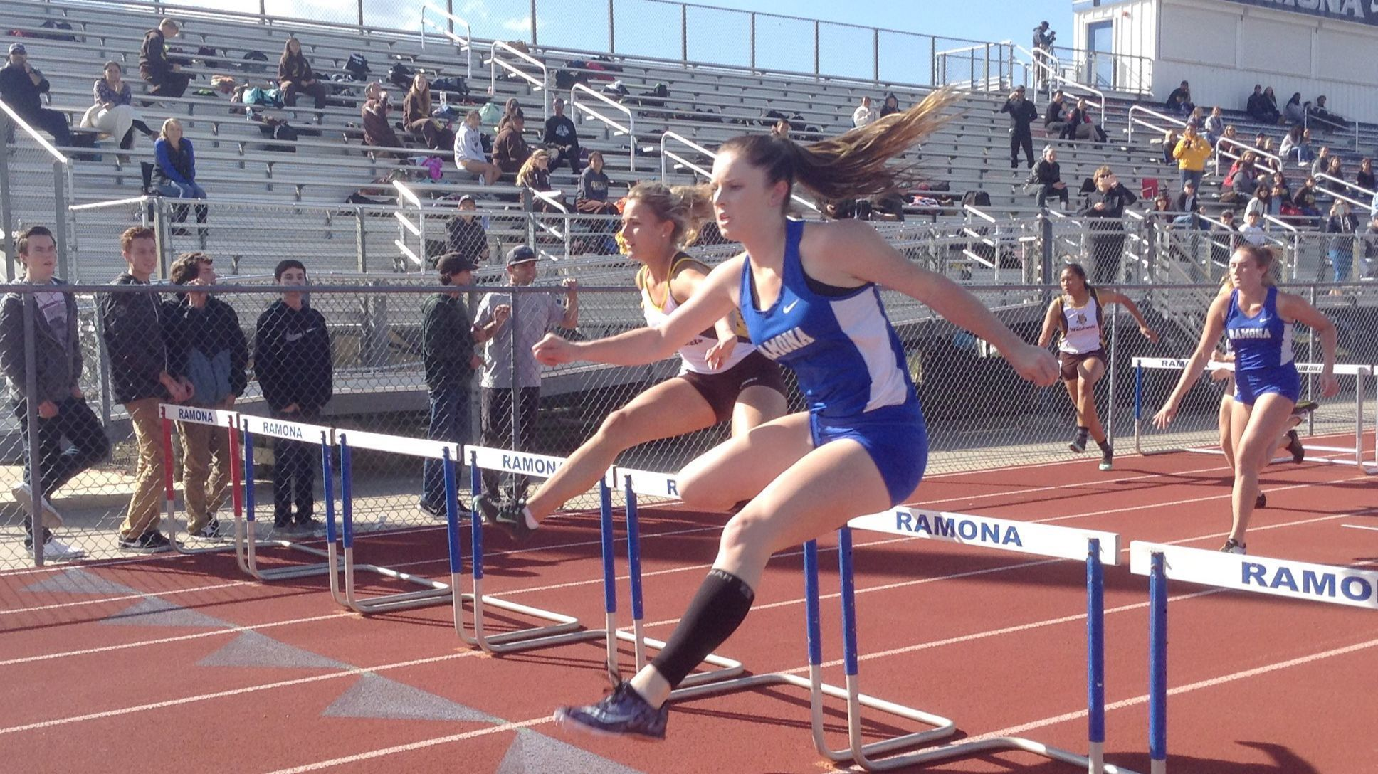 Morgann Wilson clears the last hurdle to win the 100 hurdles against El Camino in 16.37.