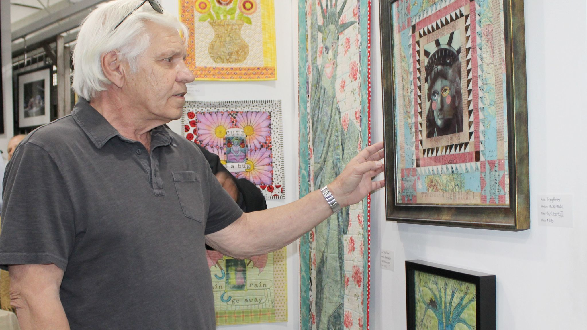 Mike LaRosa of Ramona looks at one of the works of art featured in the gallery.