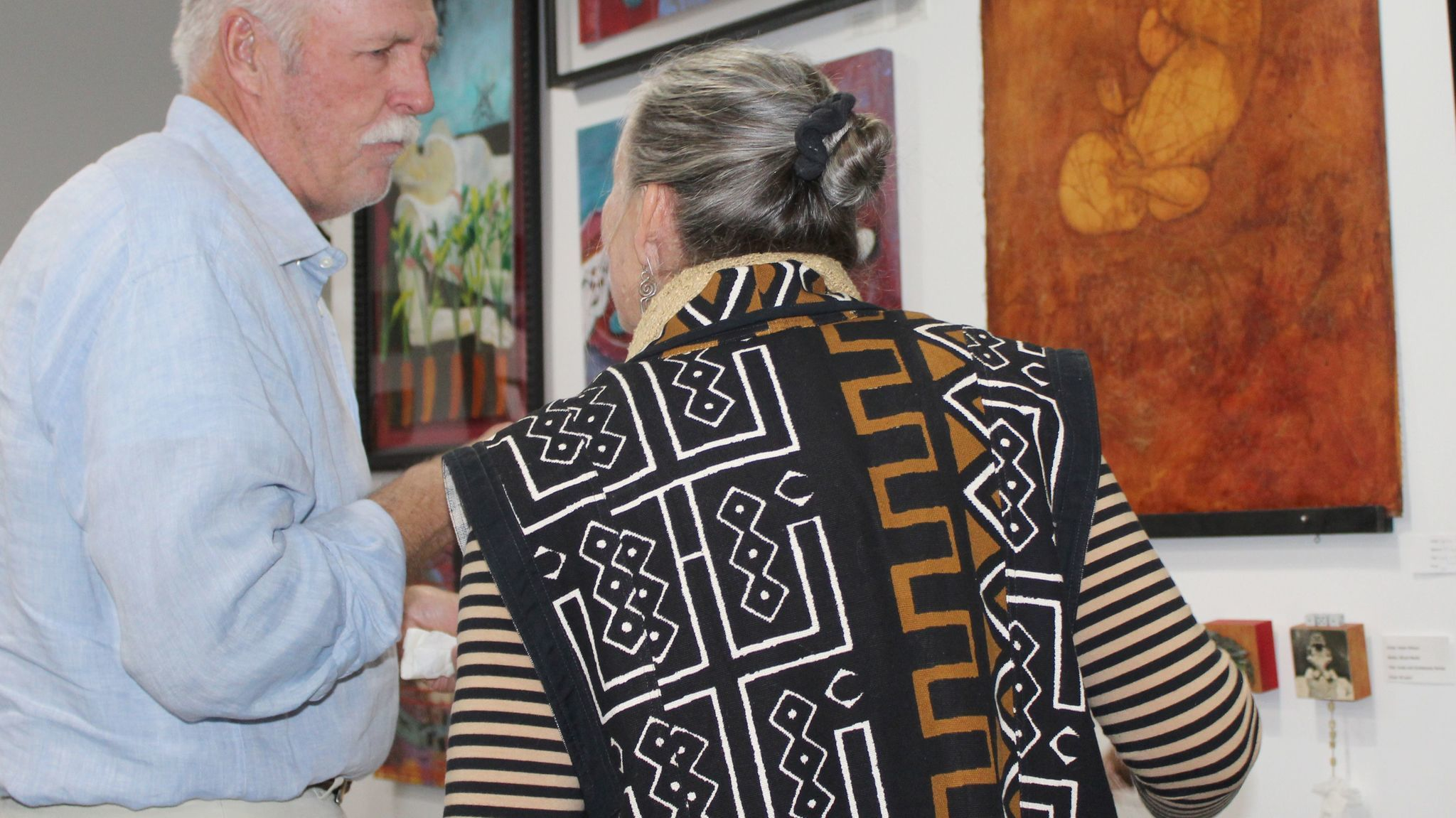 Artist David Begent, co-owner of 2Create Gallery, talks with artist Helen Wilson. Both are among the 25 artists featured in the 2017 Ramona Open Studios Tour April 8 and 9.