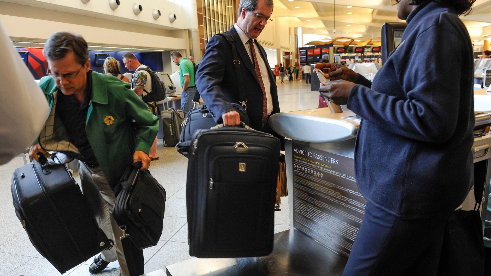 Passengers check in luggage at the Delta counter at Hartsfield-Jackson Atlanta International Airport.