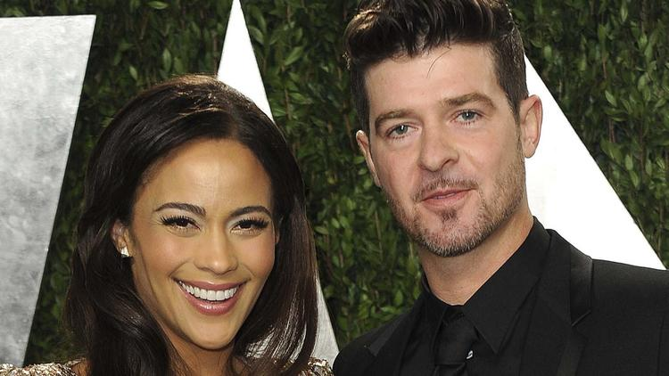 Paula Patton and Robin Thicke are seen in early 2013. (Jordan Strauss / Associated Press)