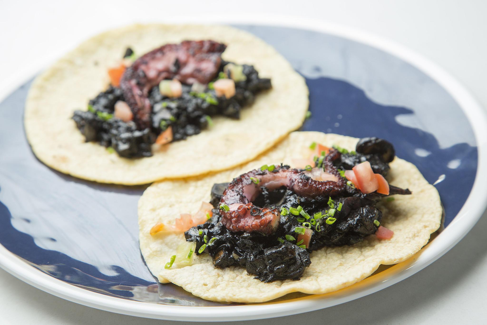 The Yucatán-style seafood menu at Gilberto Cetina Jr.'s Holbox in Mercado La Paloma includes octopus tacos. (Myung J. Chun / Los Angeles Times)
