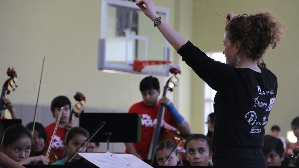 Jackie DesRosier conducts a YOLA at HOLA youth orchestra spring concert. (YOLA at HOLA)