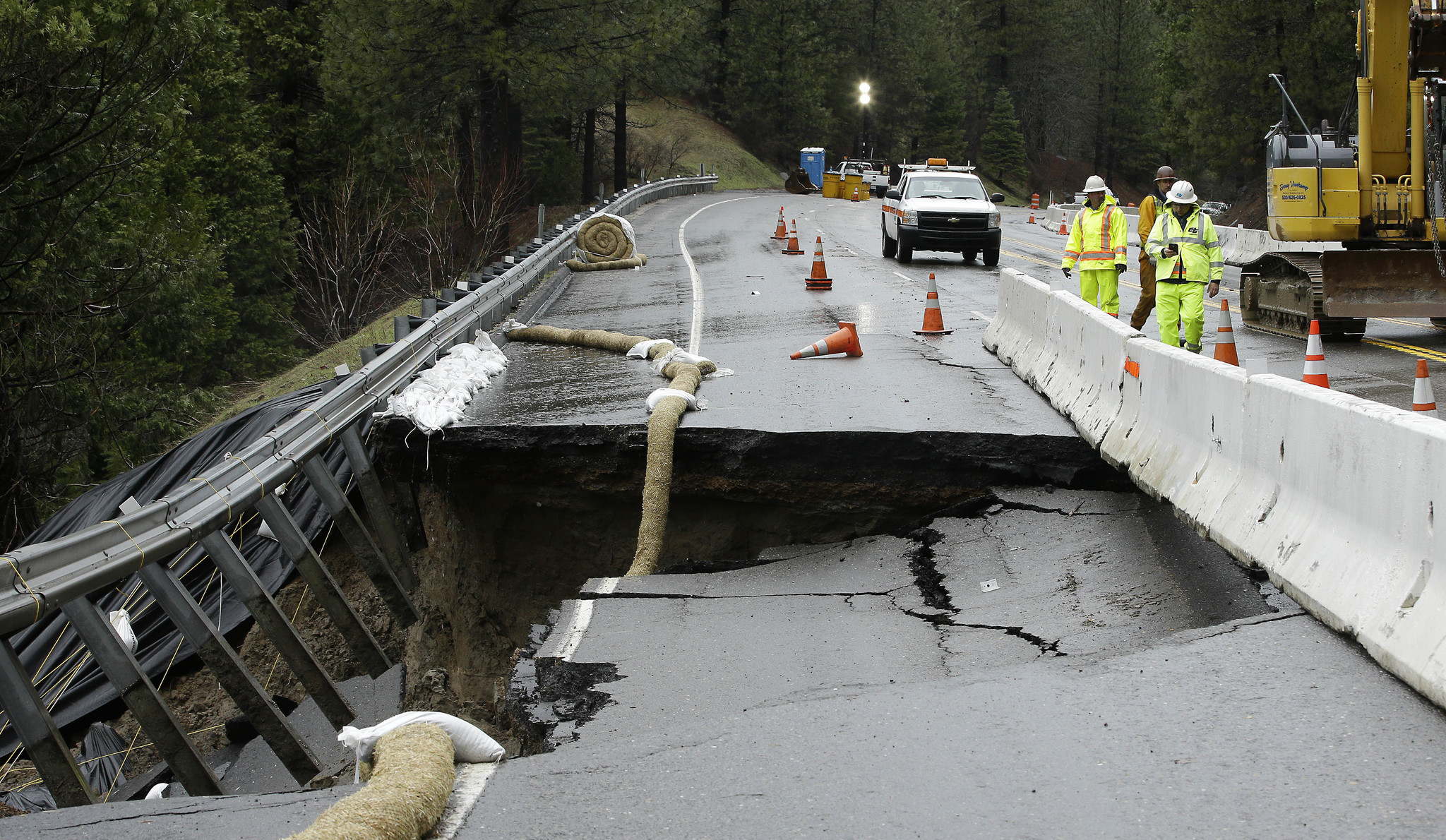 Heavy storms caused parts of the shoulder and one lane of westbound Highway 50 to give way in February near Pollock Pines. (Rich Pedroncelli / AP)