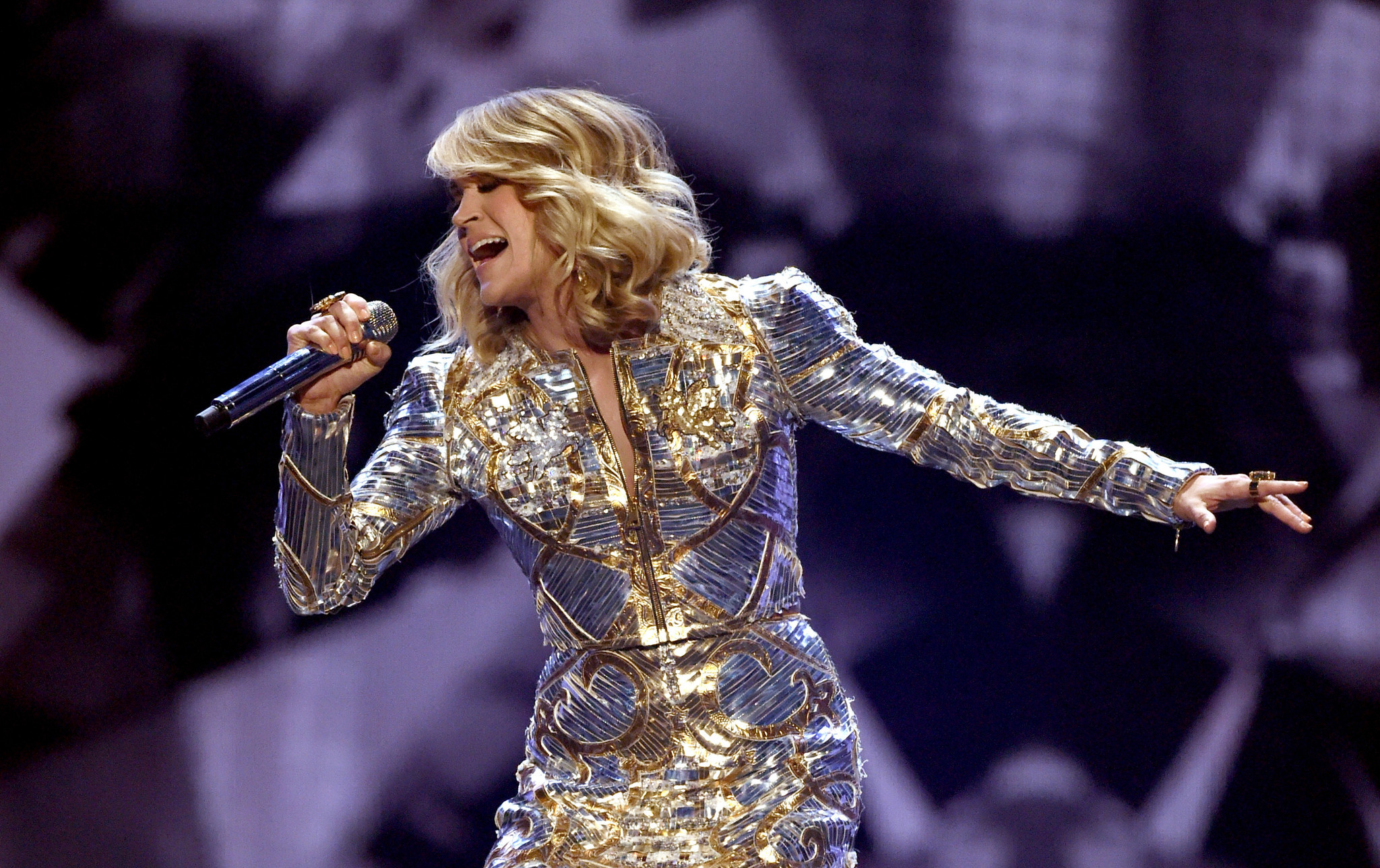 Carrie Underwood performs at the 52nd Academy of Country Music Awards in April 2017. (Ethan Miller / Getty Images)