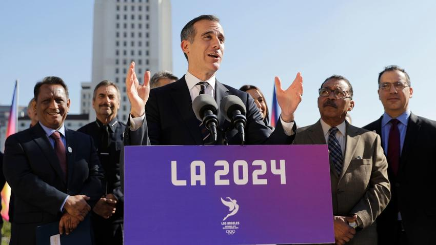 Los Angeles Mayor Eric Garcetti, center, speaks during a news conference. The city had made a bid on the 2024 Games.