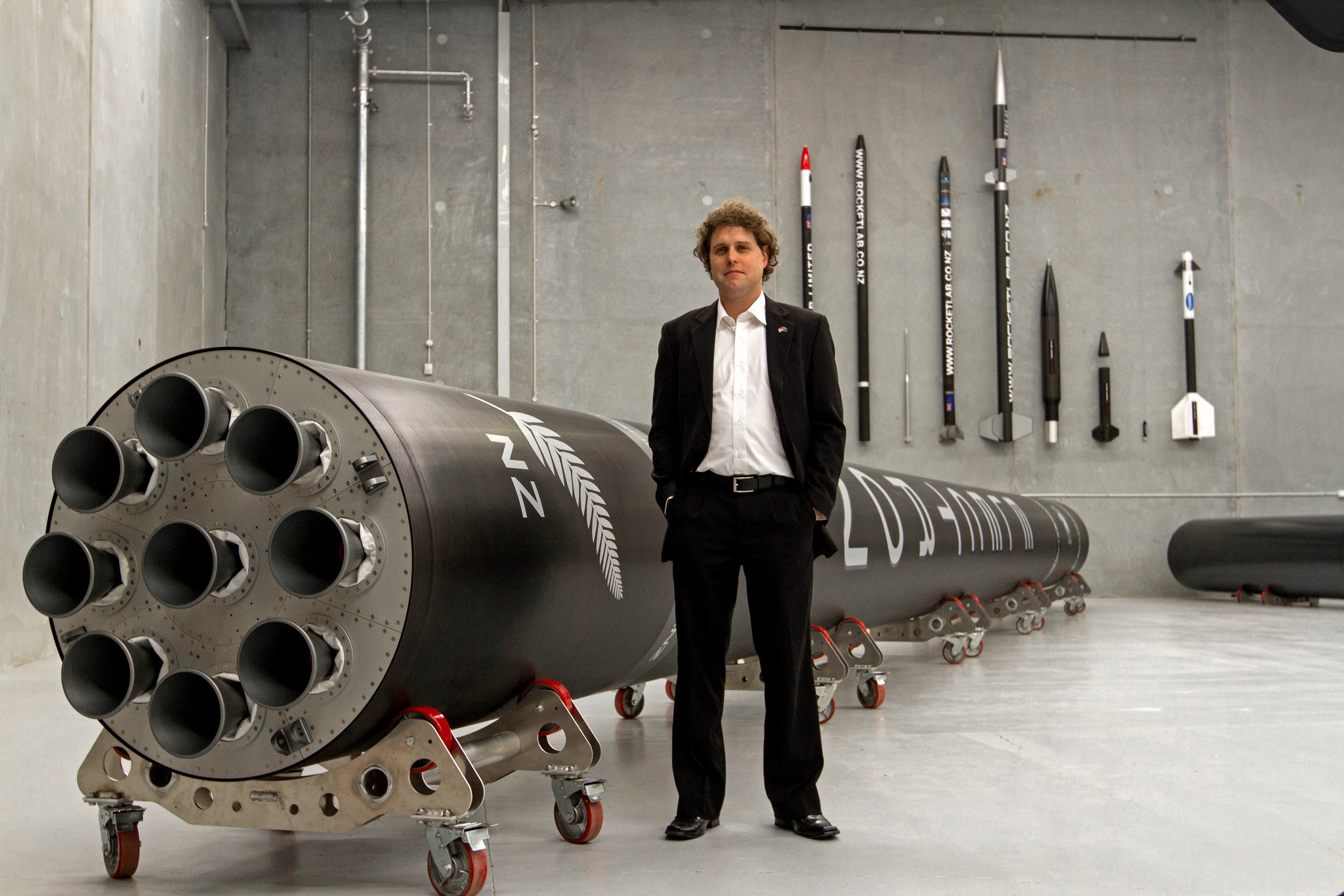 Peter Beck, Rocket Lab's chief executive, with the company's Electron rocket.