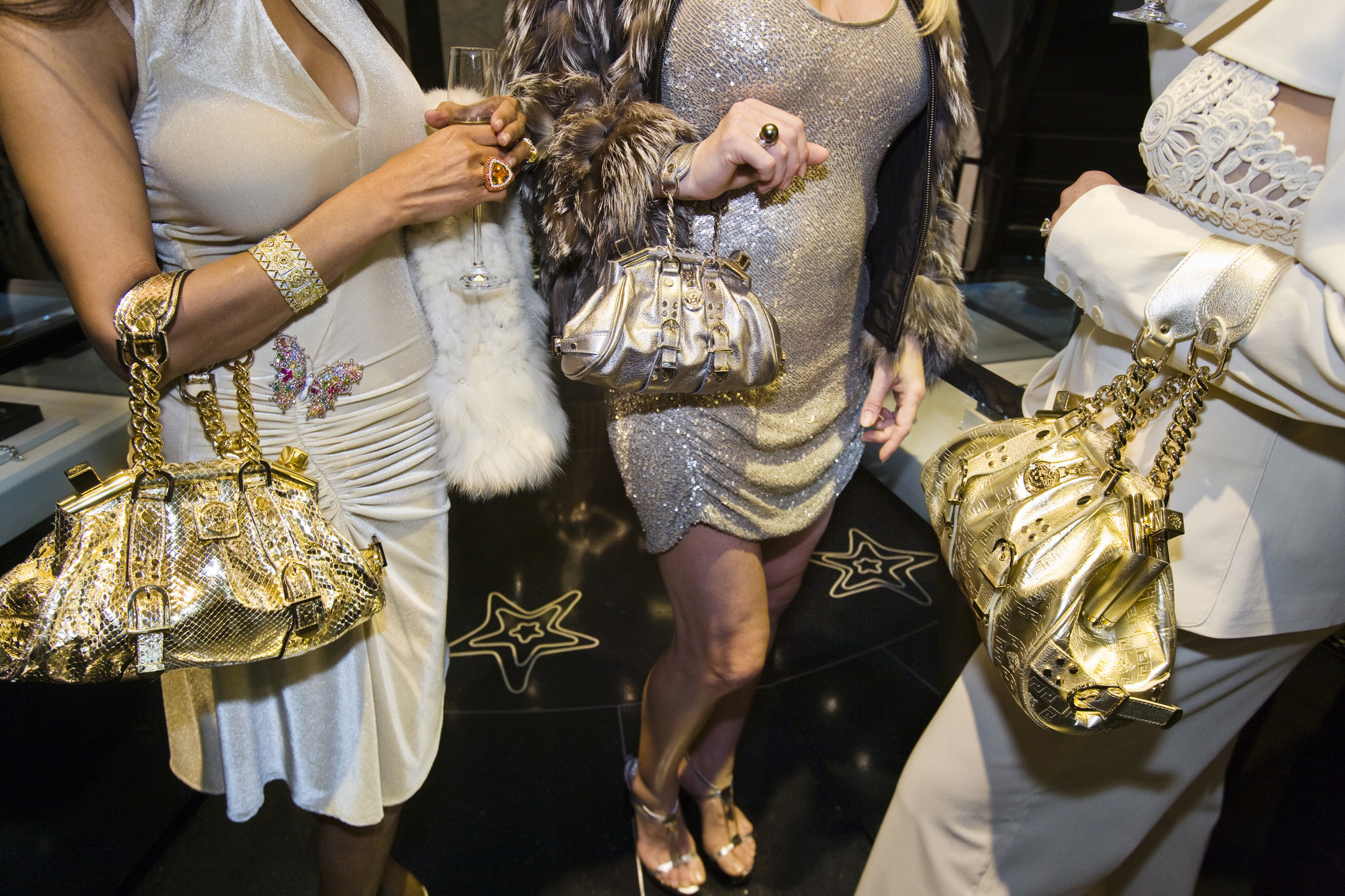 Jackie and friends with Versace handbags at a private opening at the Versace store, Beverly Hills, 2007.