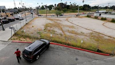 The empty lot at 1st and Lorena streets where a nonprofit developer wants to build homeless housing.