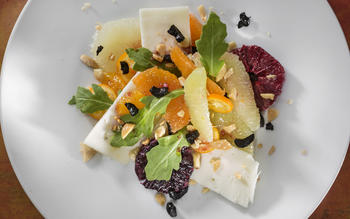 Laura's winter citrus salad with montealva, arugula, black olives and marconas.