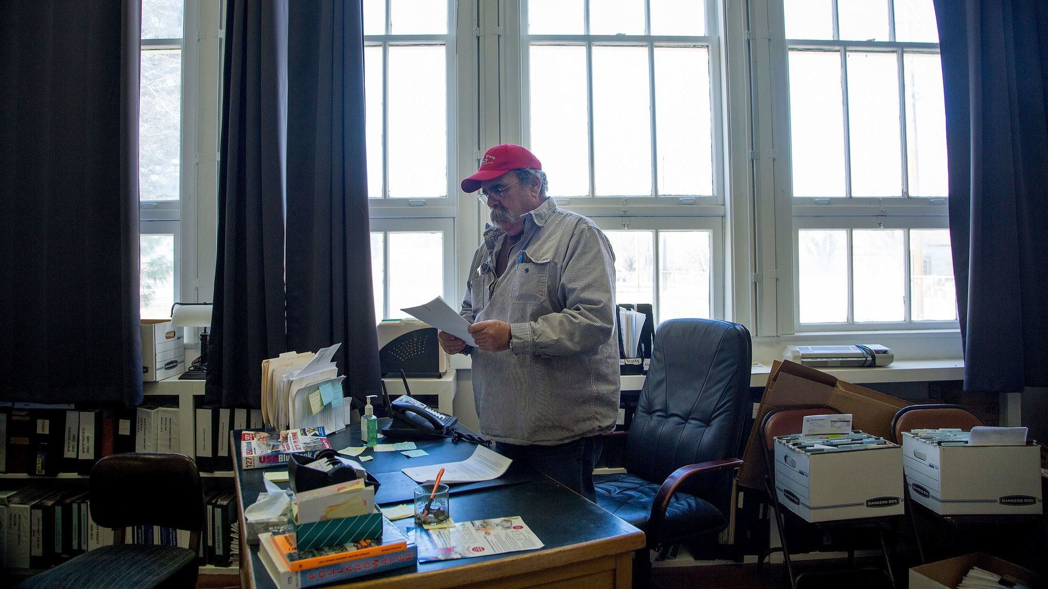 Loyalton Mayor Mark Marin, at his City Hall desk, has the job of sorting through the budget mess he inherited — including the city opting out of the state pension fund.