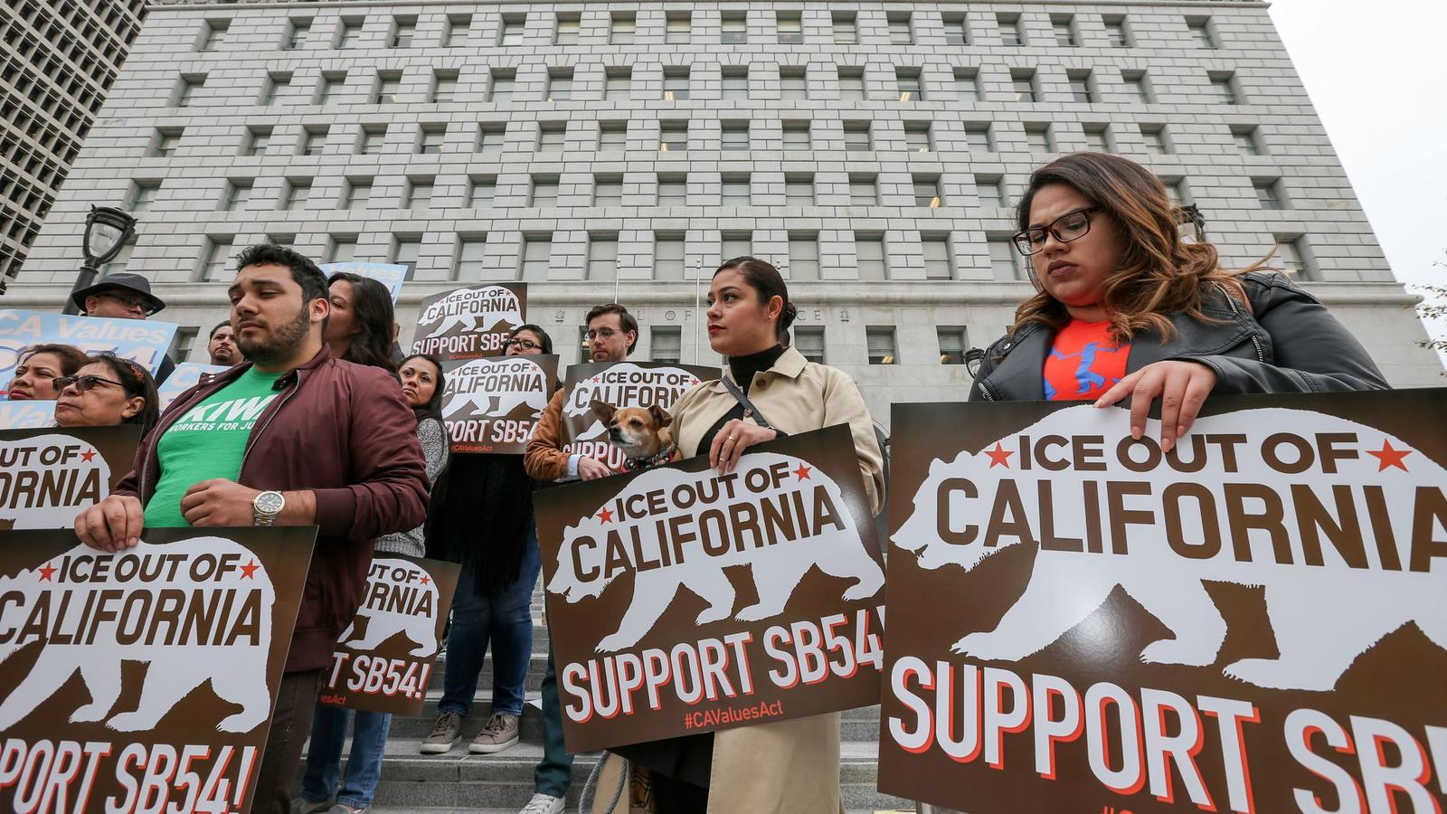 Supporters of state sanctuary bill SB 54 rally outside the Hall of Justice. (Irfan Khan / Los Angeles Times)