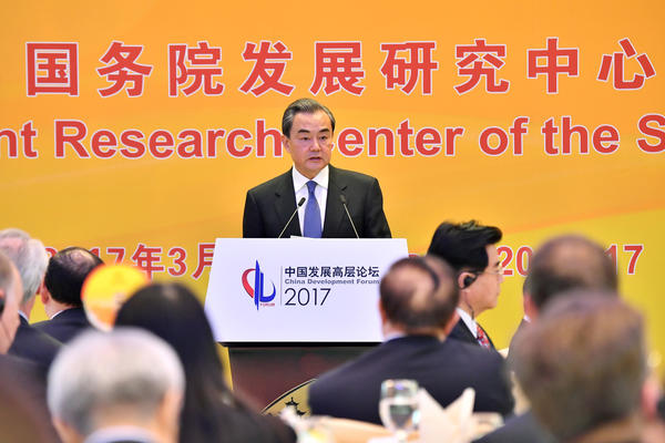Chinese Foreign Minister Wang Yi delivers a speech at the China Development Forum in Beijing in March. (Xinhua / TNS)