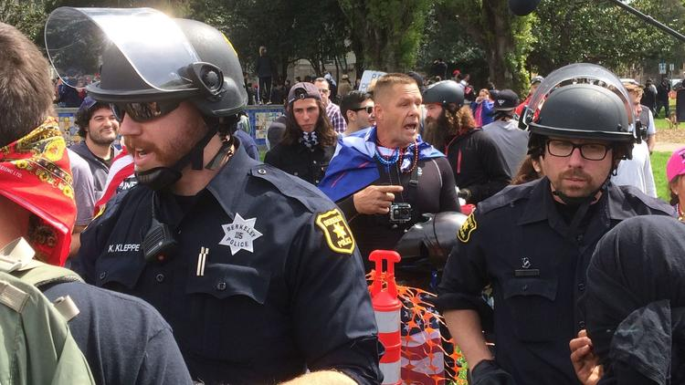 Berkeley police separate Trump supporters and anti-Trump demonstrators.