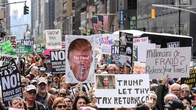 Tax day demonstrators demand that Trump release his tax returns