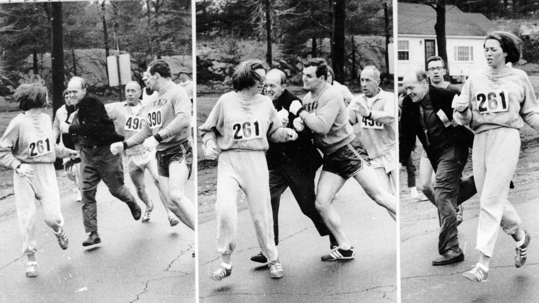Boston Marathon official Jock Semple tries to eject Kathrine Switzer (261) in 1967, but Tom Miller runs interference and blocks him out.