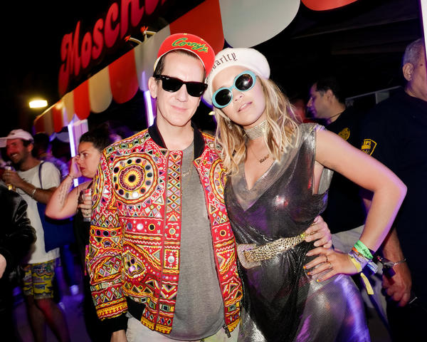 Designer Jeremy Scott and Rita Ora pose at Scott's annual Coachella bash on April 15. (David X Prutting / BFA)