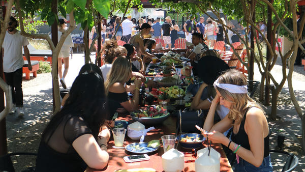 Guests attend a family-style meal at Levi's Coachella brunch in Palm Springs on Saturday. (Eric Charbonneau for Levi's)