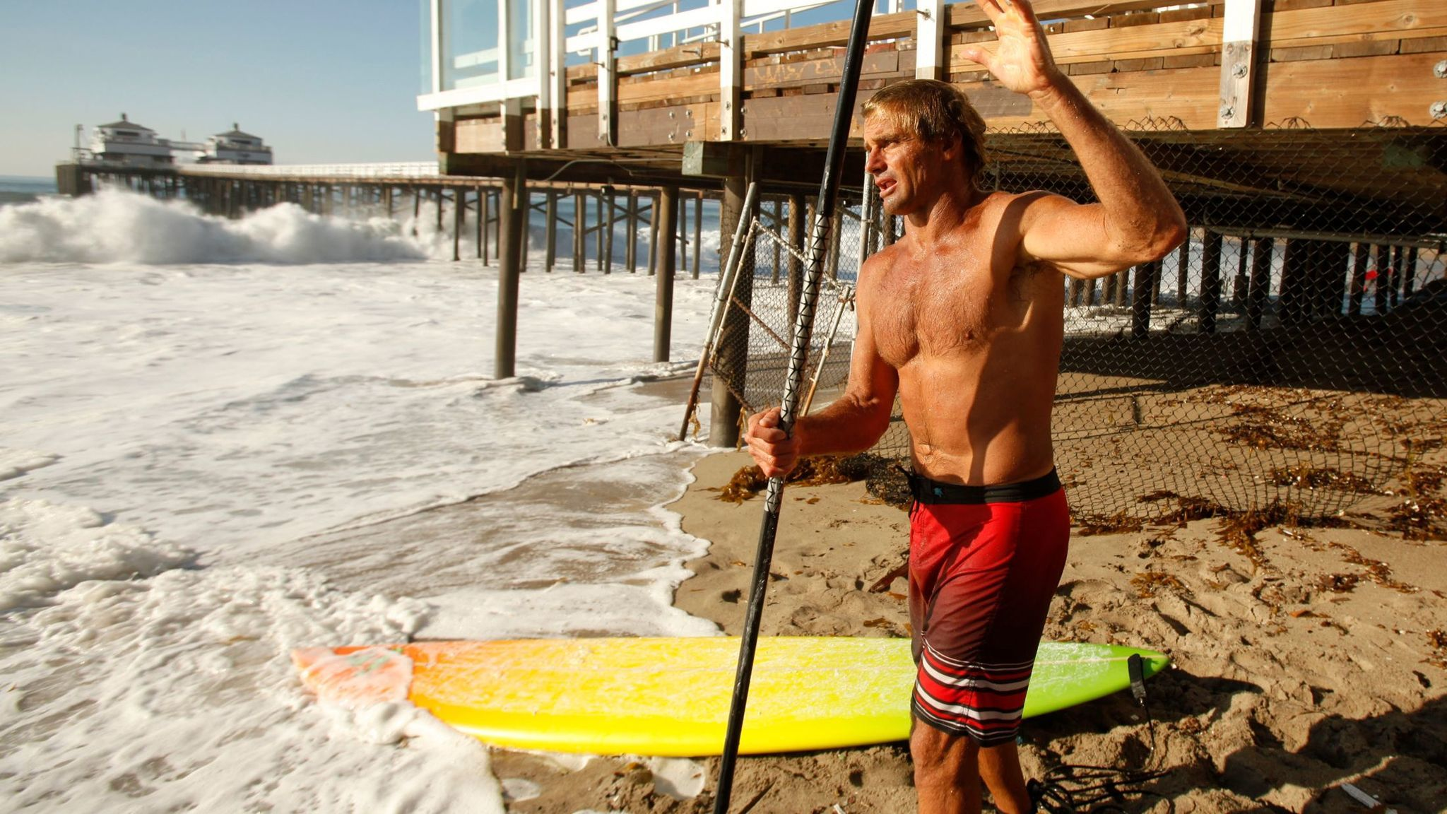 Renowned surfer Laird Hamilton prepares his standup paddle board in Malibu in this 2014 file photo.