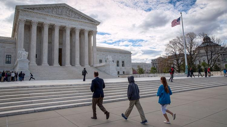 Visitors arrive at the U.S. Supreme Court. The case before the justices involved two defendants in Colorado. (J. Scott Applewhite / Associated Press)