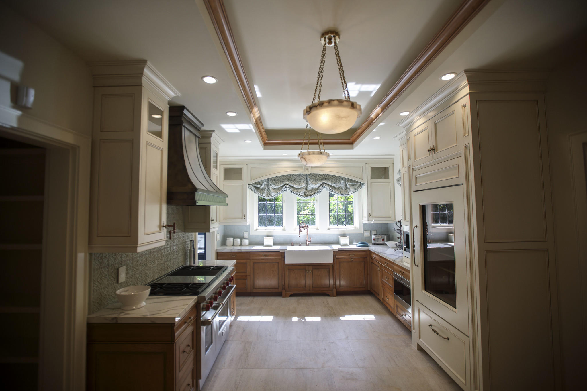 The kitchen by D Christjan Fine Cabinetry Design & Manufacturing, after renovations.