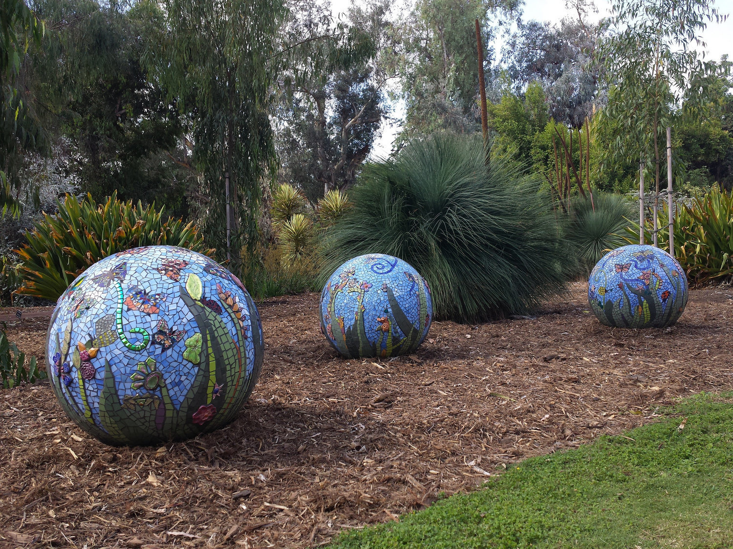 """Pollinators Paradise,"" Los Angeles County Arboretum, (temporary exhibit) Three 30-inch spheres, repurposed glass, and ceramic."