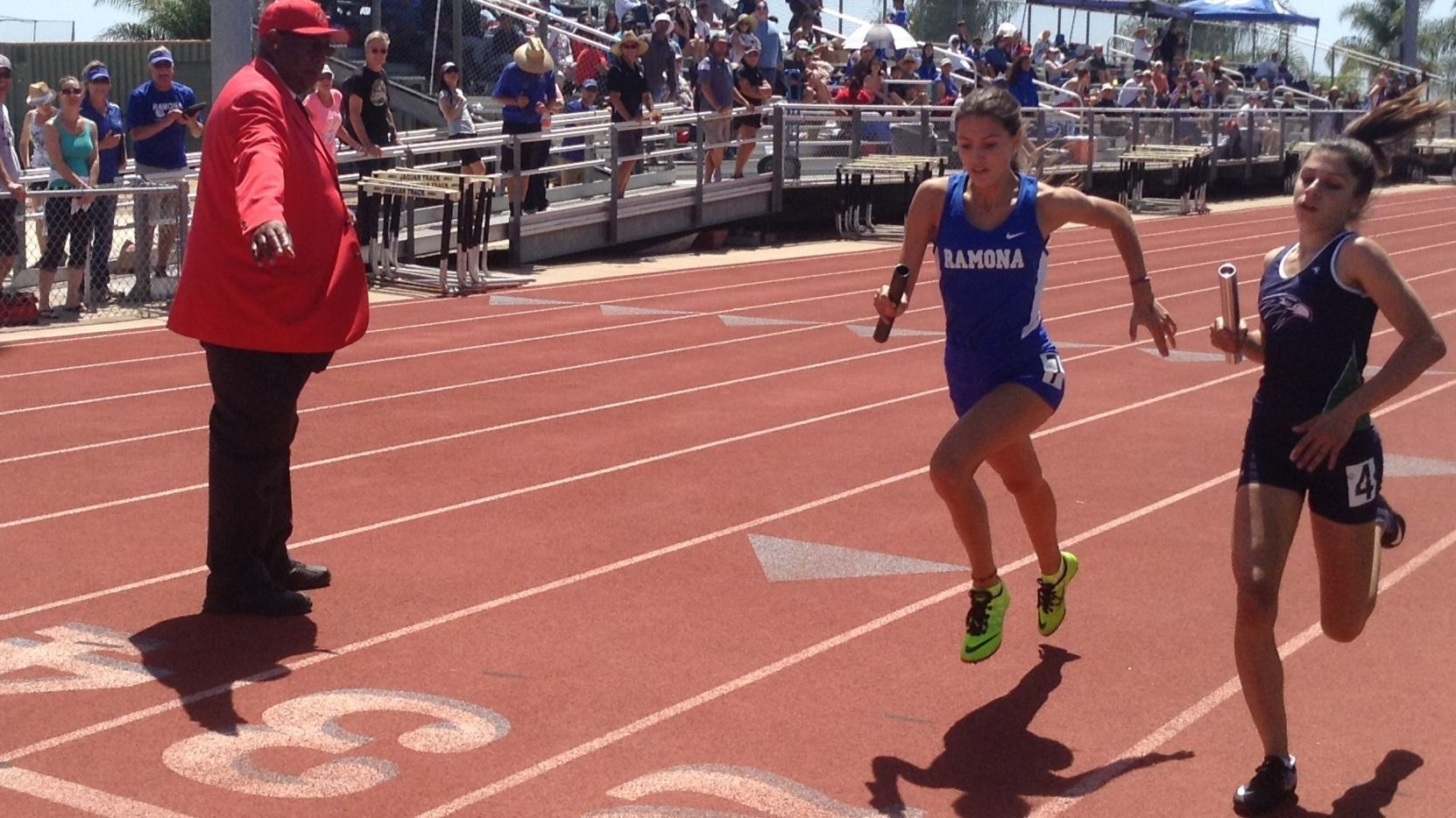 Rayna Valade passes del Norte runner at the finish line to help Ramona take second in the 4x400-meter relay.