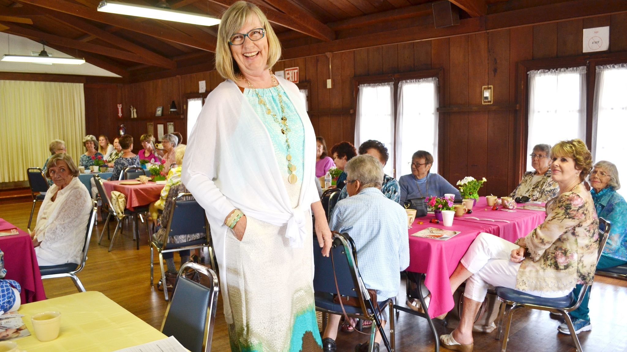 Wearing a Bahama Breeze halter maxi dress, Barbara Spain finds the side pocket as she models it for guests at the fashion show.