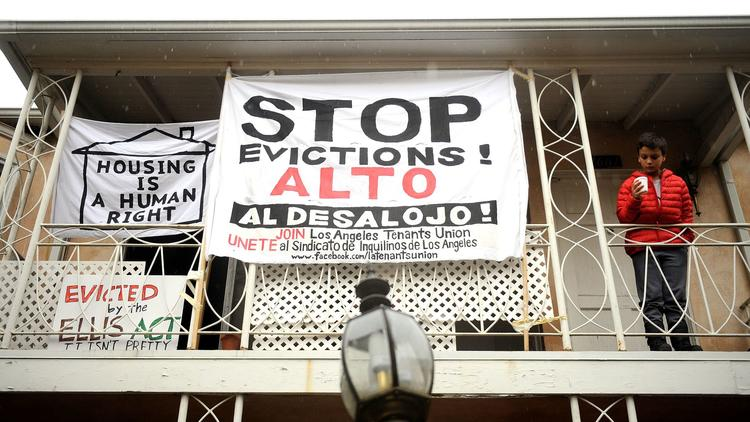 Anti-eviction signs decorate the Rodney Drive apartments in Los Feliz. (Christina House / Los Angeles Times)