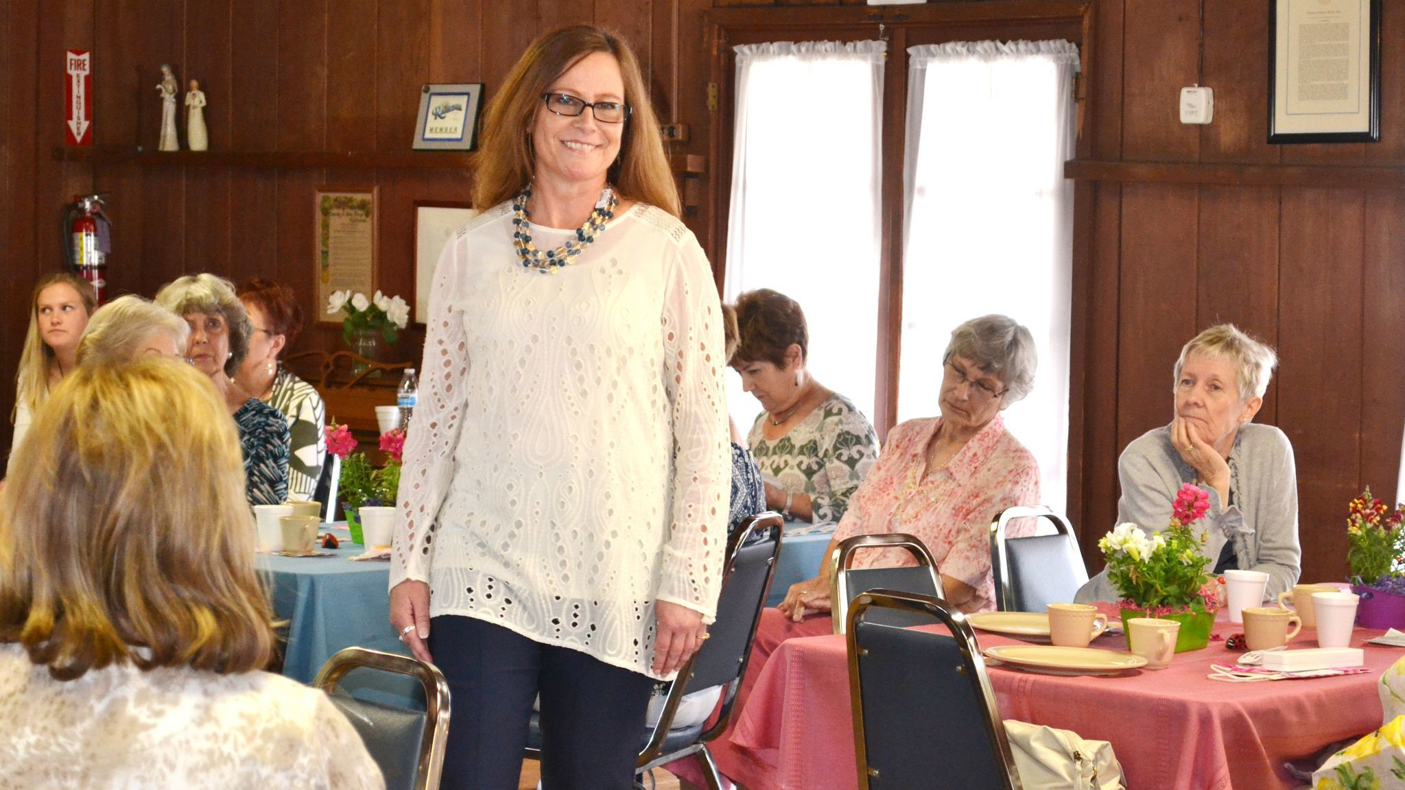 Sandra Ward models a lace top accented with a necklace of faux sea glass beads.