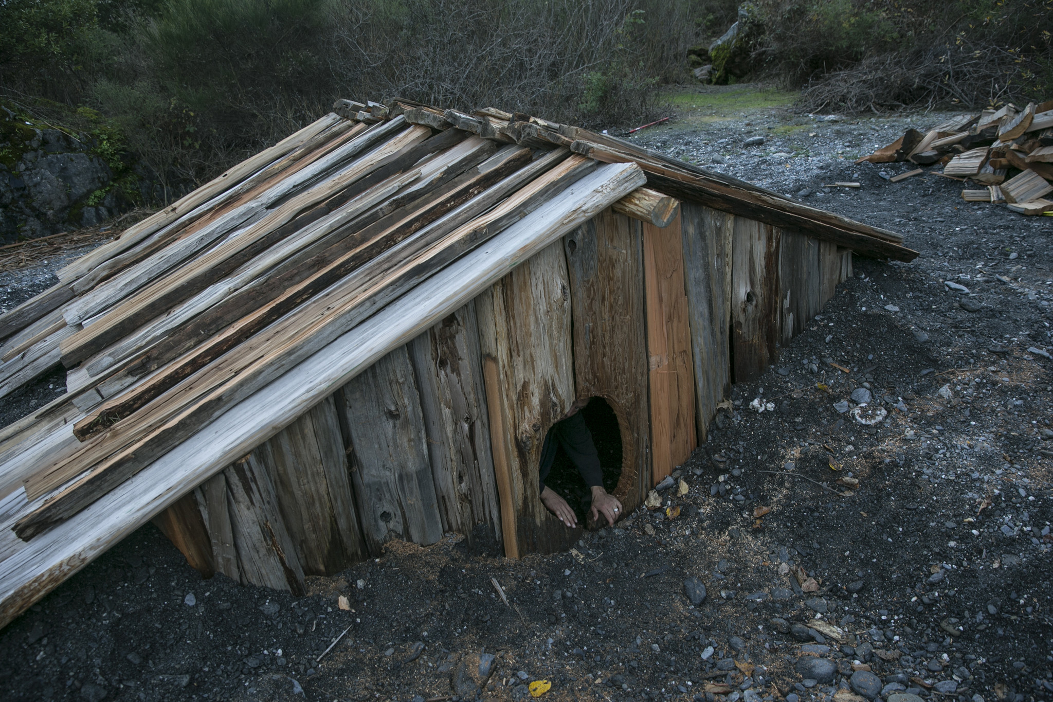 The Yurok people traditionally lived in redwood plank villages along the river. The sweat house, lik