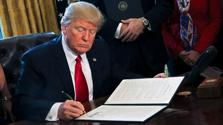 Trump signs executive orders on financial regulations