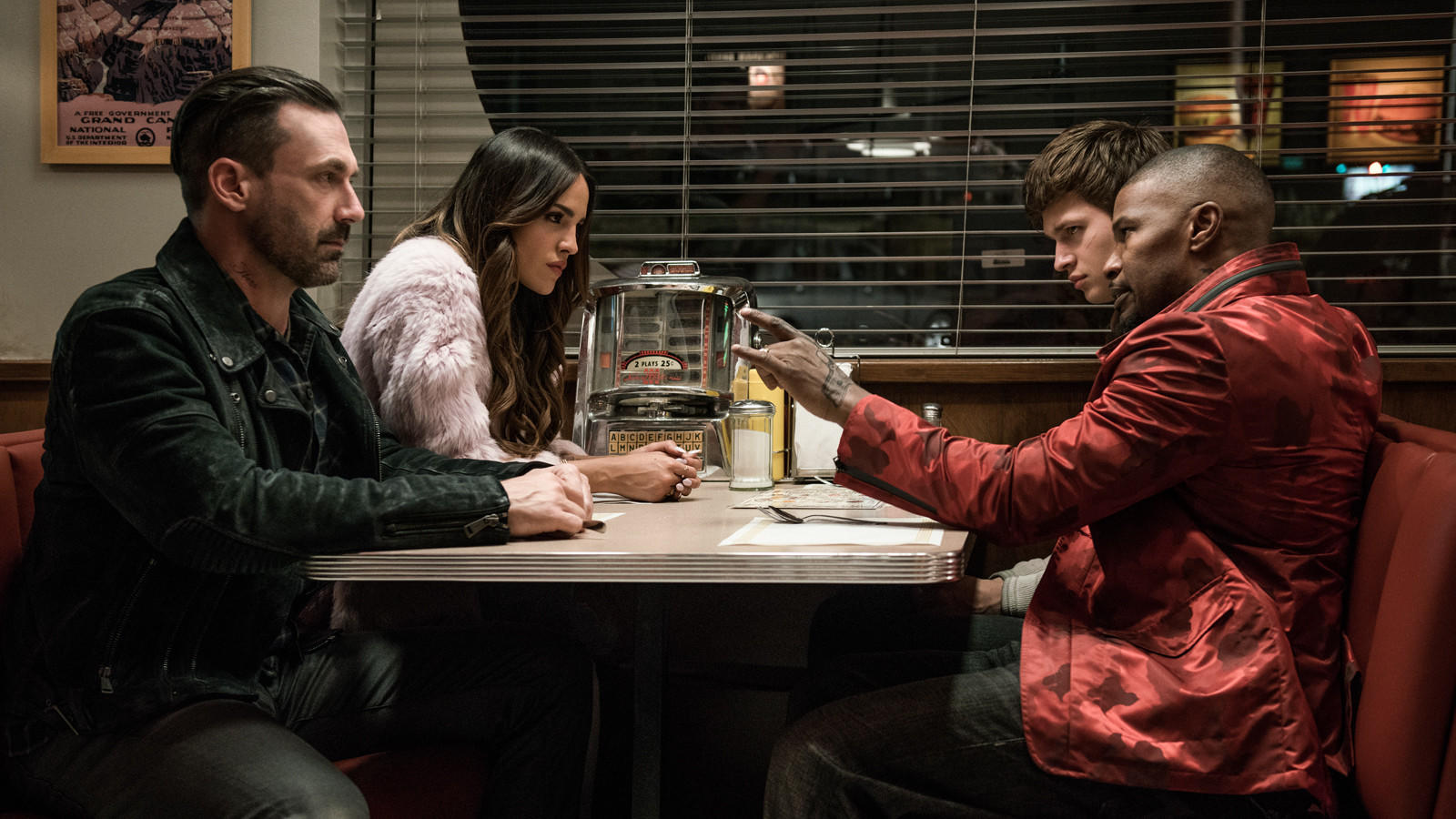 "From left: Buddy (Jon Hamm), Darling (Eiza Gonzalez), Baby (Ansel Elgort) and Bats (Jamie Foxx) discuss the next heist in ""Baby Driver."" (Wilson Webb / Sony Pictures)"