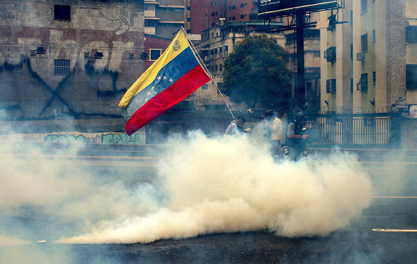 At least 12 people killed overnight amid unrest in Venezuela, officials say