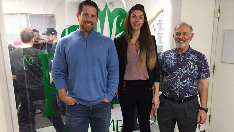 Dispensary owners David Spradling and Mark Pelter, right, with cannabis pharmacy technician Shayna S