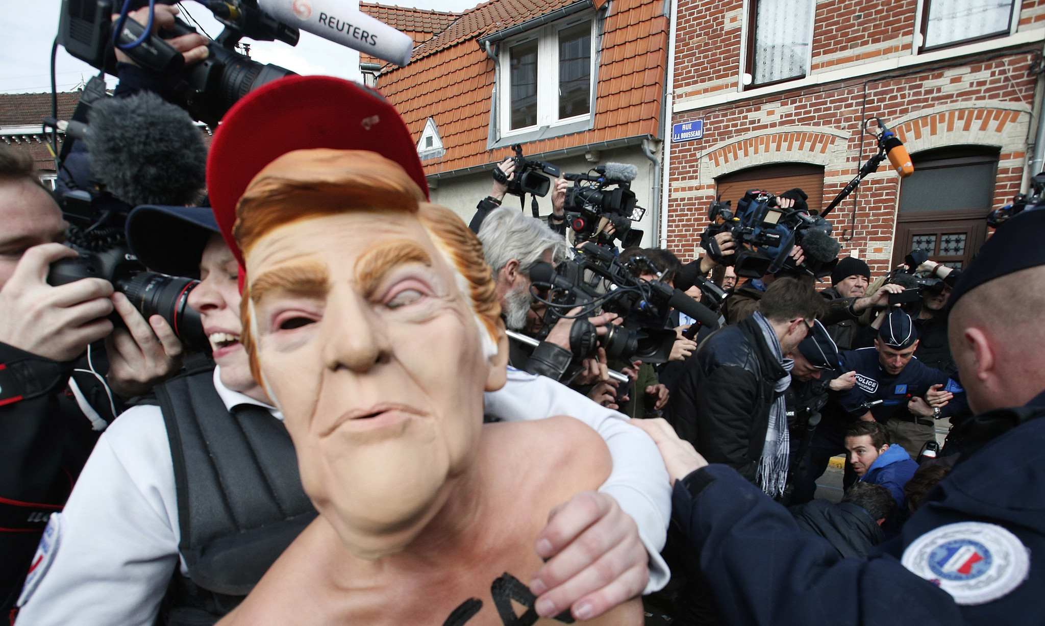An activist is detained in Henin-Beaumont, France, where far-right candidate Marine Le Pen voted during the first round of the French presidential election on Sunday. (Michel Spingler / Associated Press)