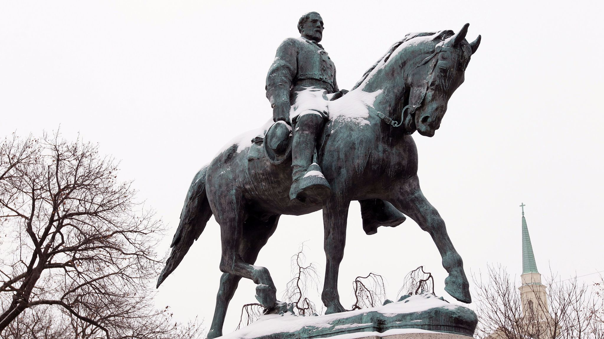 A statue of Robert E. Lee collects snow in Lee Park in Charlottesville, Va., on March 3, 2014.