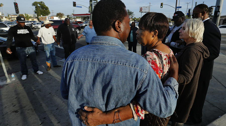 At the corner of Florence and Normandie, marking causes of L.A. riots: 'It's important to remember what started it'