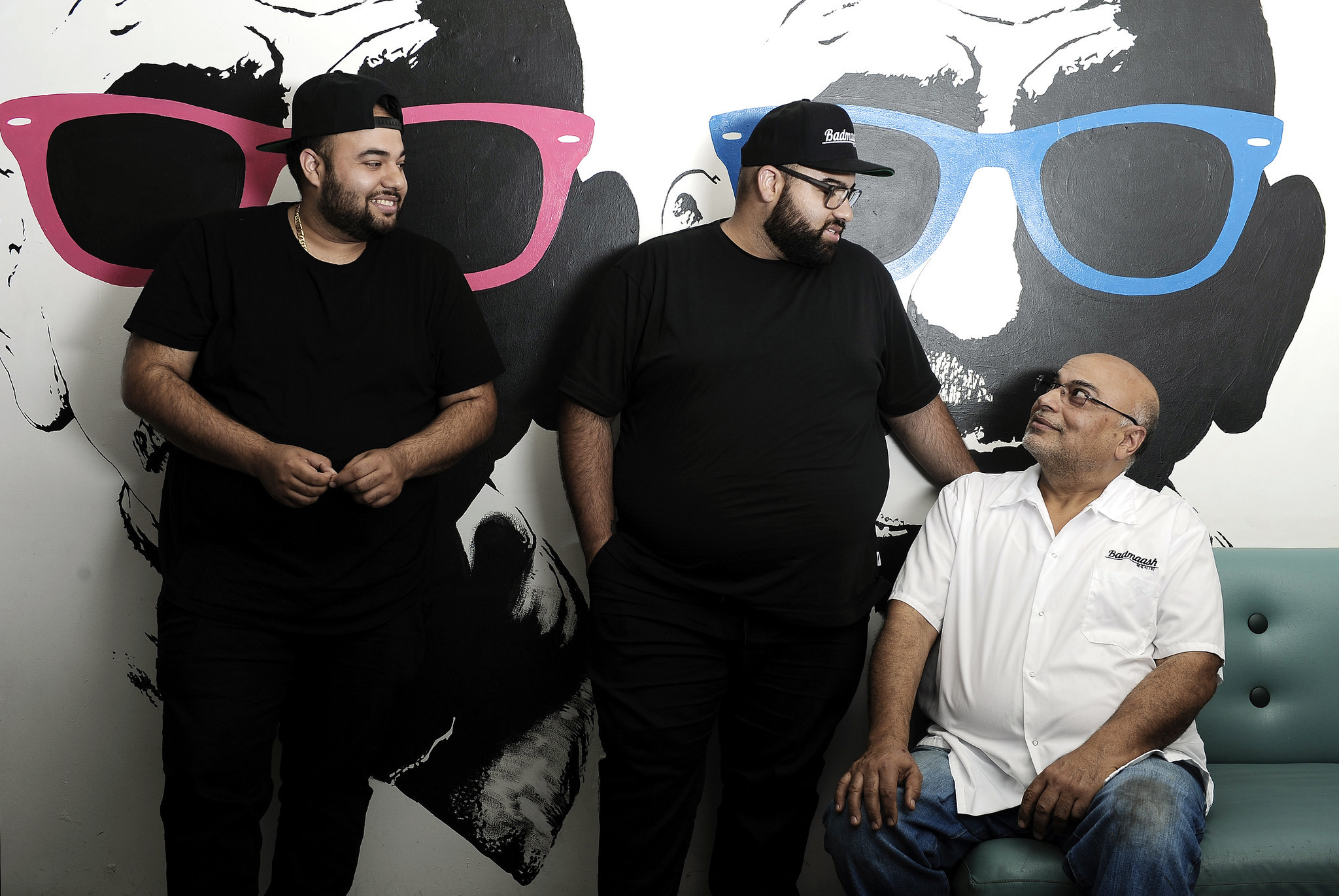 Pawan Mahendro, right, and sons Nakul and Arjun are chefs and owners of Badmaash.
