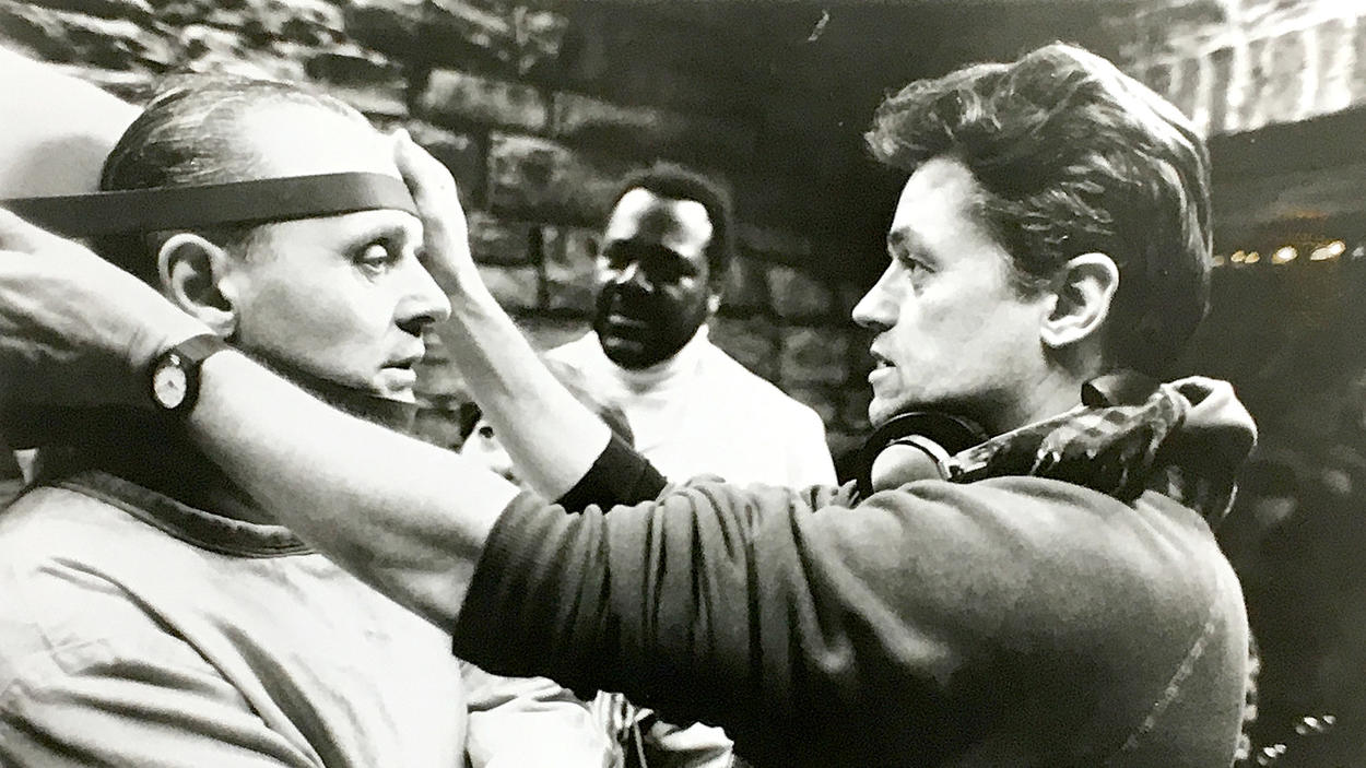 "Jonathan Demme, right, directs Anthony Hopkins on the set of ""Silence of the Lambs"" in 1990."