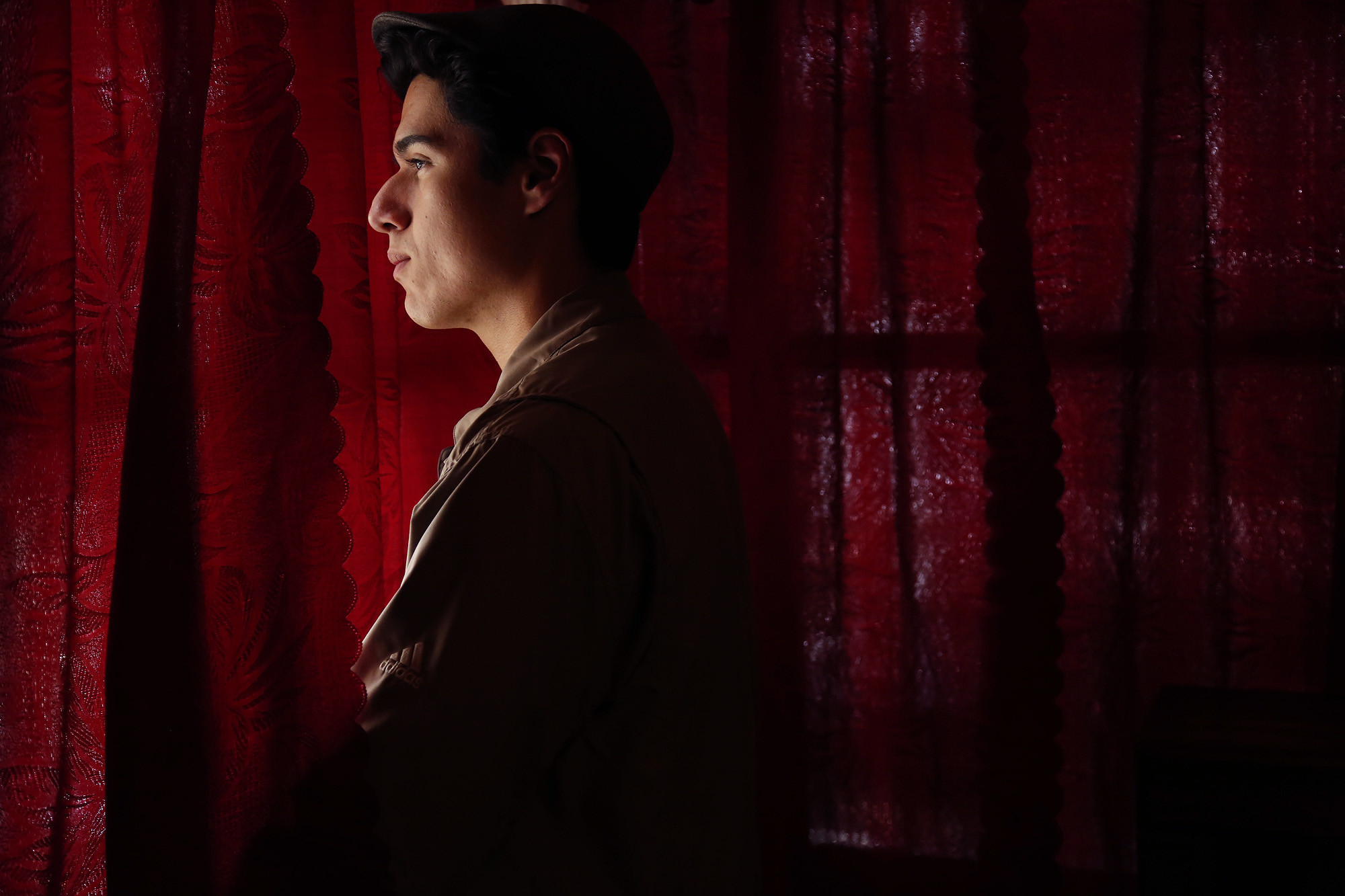Daniel Garcia, 17, stands inside his bedroom at his grandmother's home in El Sereno.