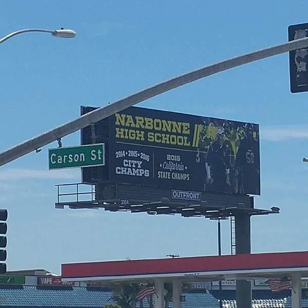 Billboard touting Narbonne football near Carson High. None