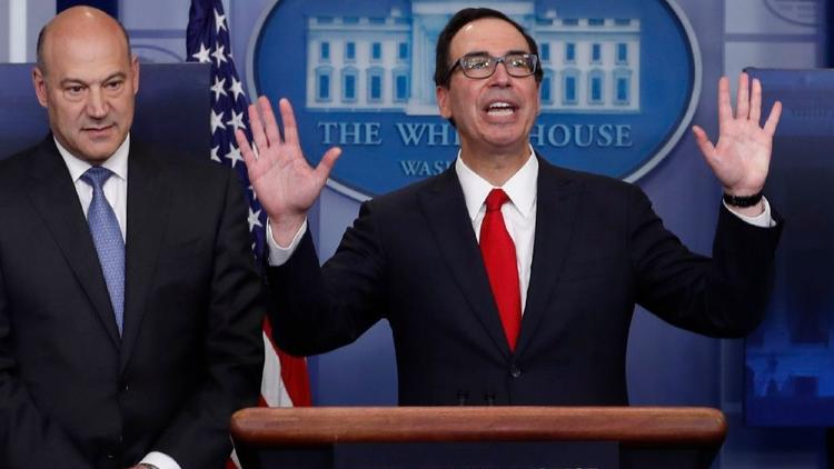 Gary Cohn, director of the National Economic Council, left, joins Treasury Secretary Steven Mnuchin in the White House briefing room on Wednesday. (Carolyn Kaster / Associated Press)