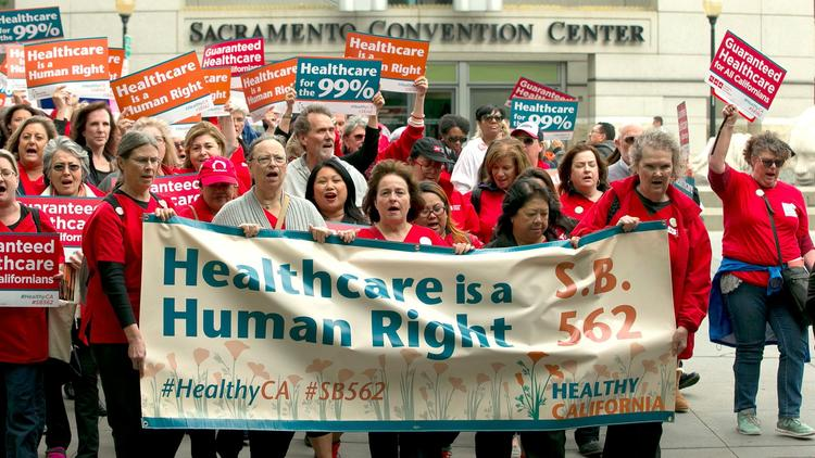 Supporters of single-payer healthcare march to the Capitol in Sacramento on April 26. (Rich Pedroncelli / Associated Press)