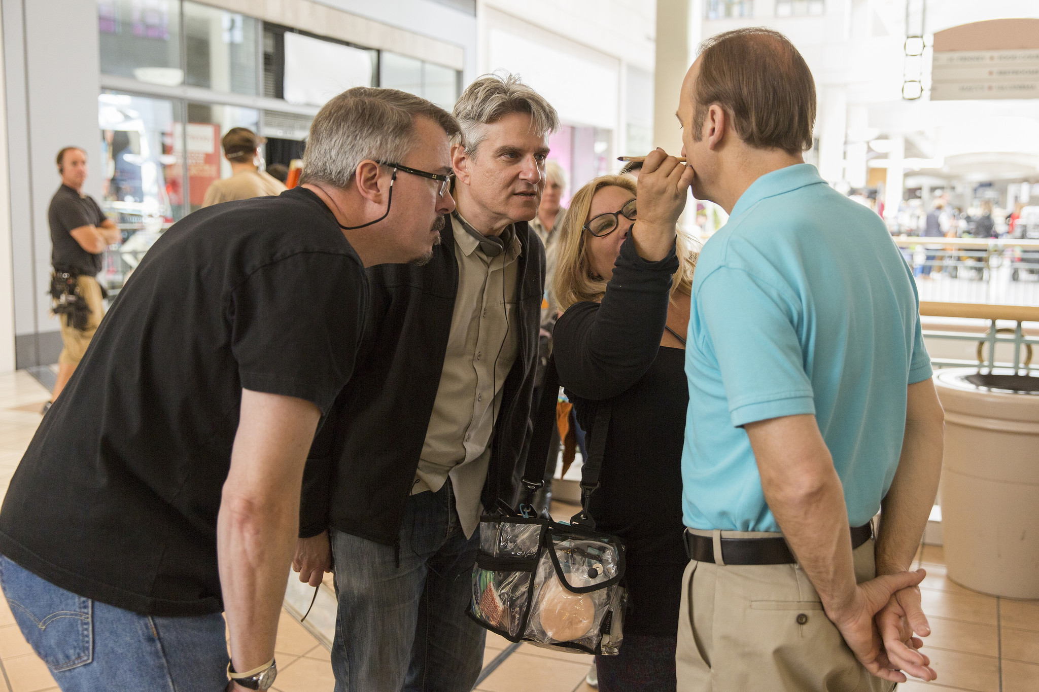 "Showrunners Vince Gilligan, from left, and Peter Gould watch a makeup artist at work on the set of ""Better Call Saul."" (AMC / Sony Pictures Television)"